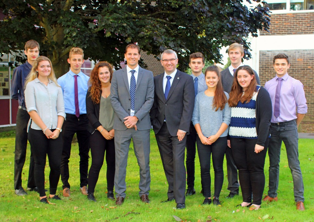 The Arnewood School's Sixth Form is celebrating a record set of results. Headteacher Nigel Pressnell (centre right) and head of sixth form, Mark Colman (centre left) with some of Year 13 students whose AS level results from last year put them in the nation's top 10% of results.