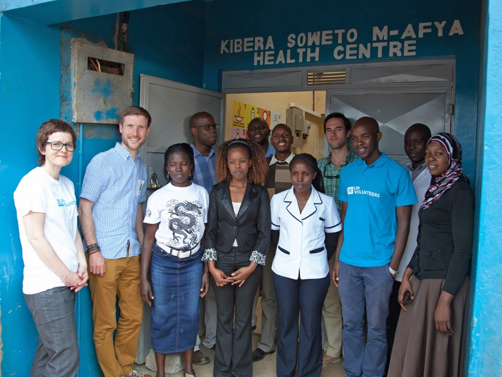 HEALTHY OUTLOOK: Ross Thornley, Strategic Director of RT Brand Communications, with colleagues, UN Volunteers and locals at the Kibera Health Centre in Nairobi, Kenya. RT Brand Communications, of Wimborne, spent 14 months rebranding the United Nations Volunteers (UNV) UNV to reposition and modernise the way the global organisation communicates and operates