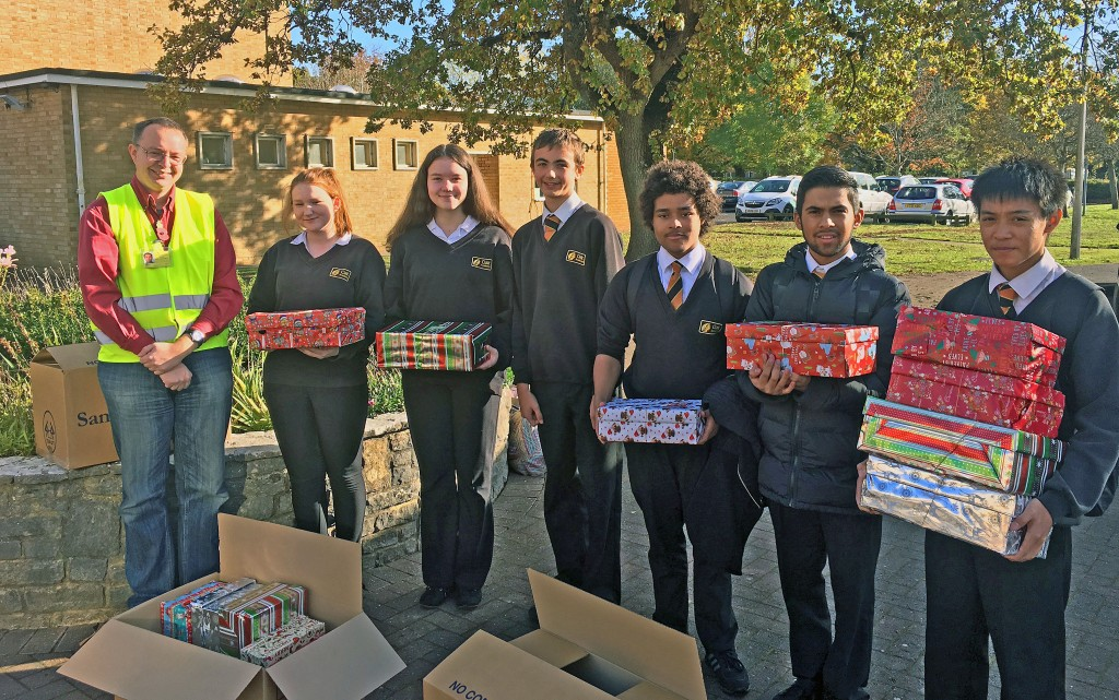 CARING: Year 11 students from Oak Academy with just some of the gift boxes collected by the school for the Samaritans' Purse Appeal.