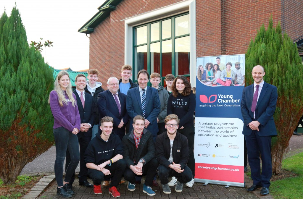 SKILLS: Gillingham School in Dorset has joined the DCCI Young Chamber scheme. Students are pictured with DCCI Young Chamber co-ordinator Will Montgomery (second left), sponsor Keith Brownhill, chief executive of Dextra (fourth left), DCCI past president Paul Collins of Westover Group (sixth left) and deputy head Mark Lavis (far right)