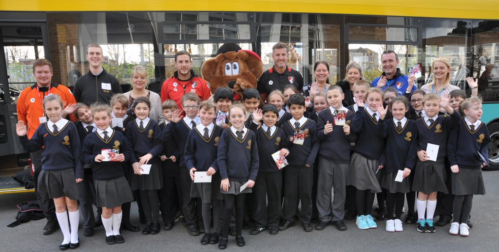 Goal! Dan Gosling, Cherry Bear and Steve Fletcher (at the rear) with children from King's Park Academy.