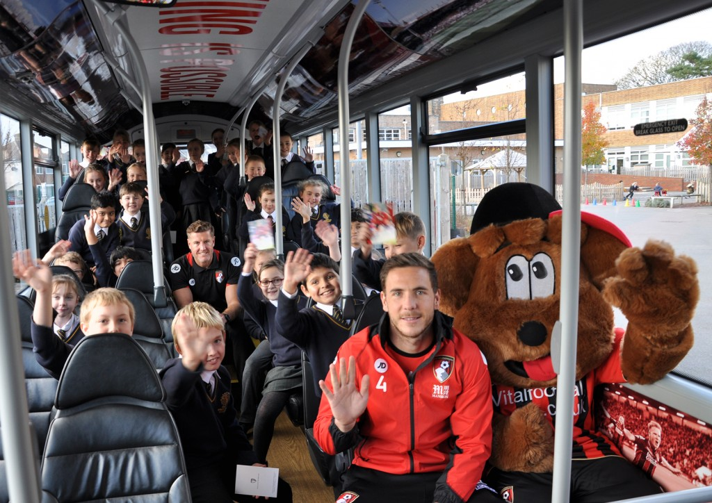 Steve Fletcher (centre) with Dan Gosling and Cherry Bear plus children from King's Park Academy.