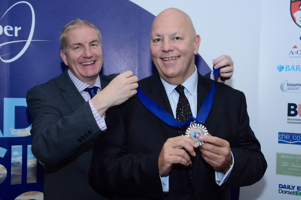 CHAMBER: New DCCI president Vincent Boni, front, is presented with his chain of office by outgoing president David McNair