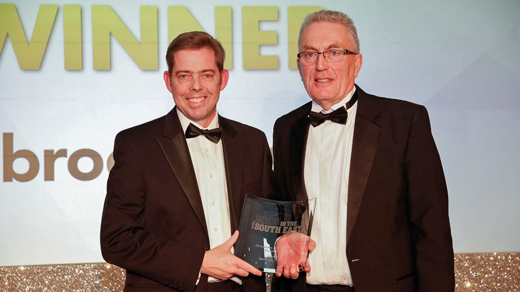AEROSPACE EXCELLENCE: From left Barnbrook Systems Chief Technology Officer Andrew Barnett receives the Aerospace and Defence Award from Stephen Myatt, of the South East International Trade Team, the Department for International Trade