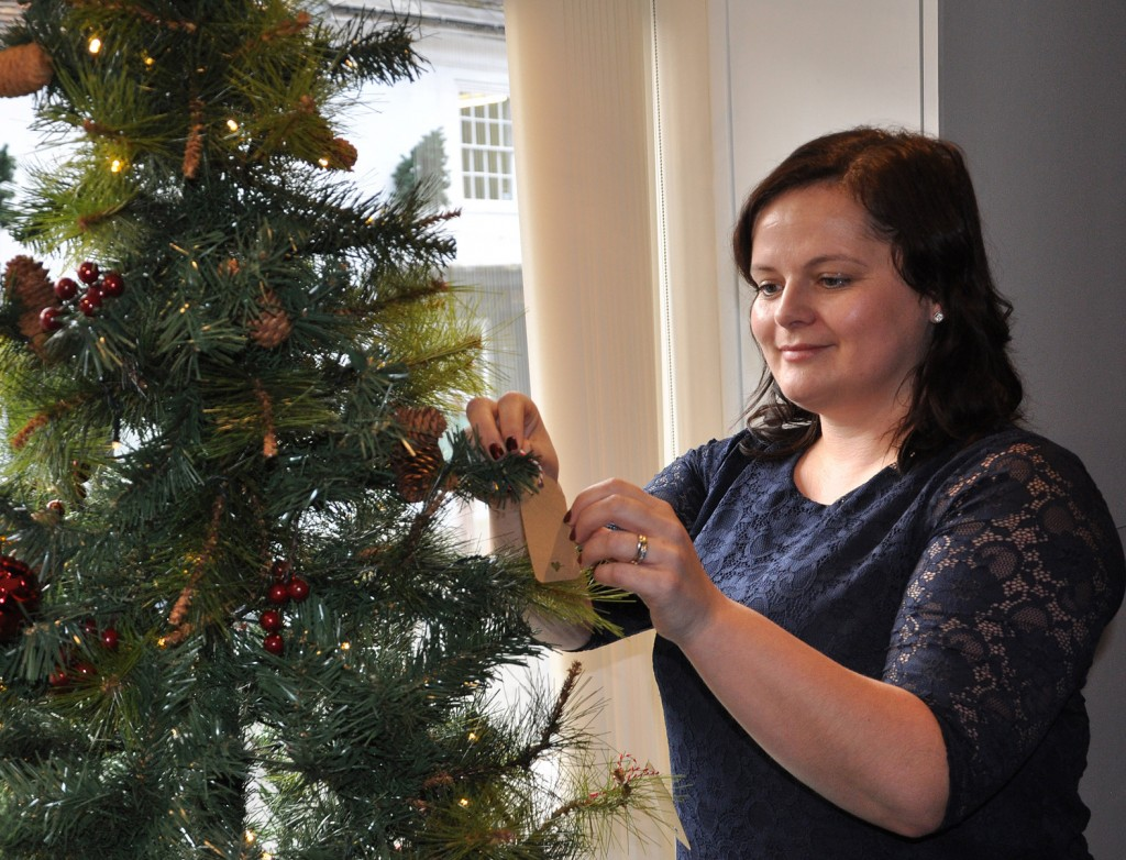 Kathryn Clark, funeral director at Lesley Shand in Blandford, puts a message on a Christmas tree.