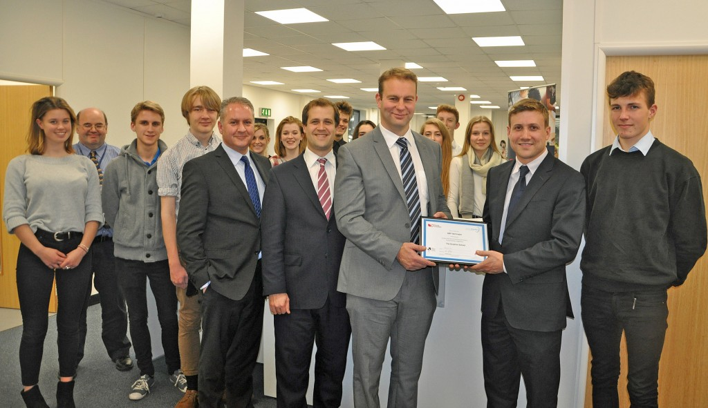 SHERBORNE SUCCESS: Will Montgomery, second right, hands Young Chamber certificate to Mark Eastwood from ABP Yetminster, third right. Stephen Strowger from the Gryphon School is fourth right with DCCI chief executive Ian Girling fifth right. They are pictured with Gryphon School sixth formers