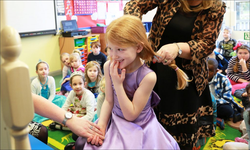 Seven year old Emma Denton of Merley First School cutting the hair she will donate to the Little Princess Trust after spending two years growing it back after her previous donation.