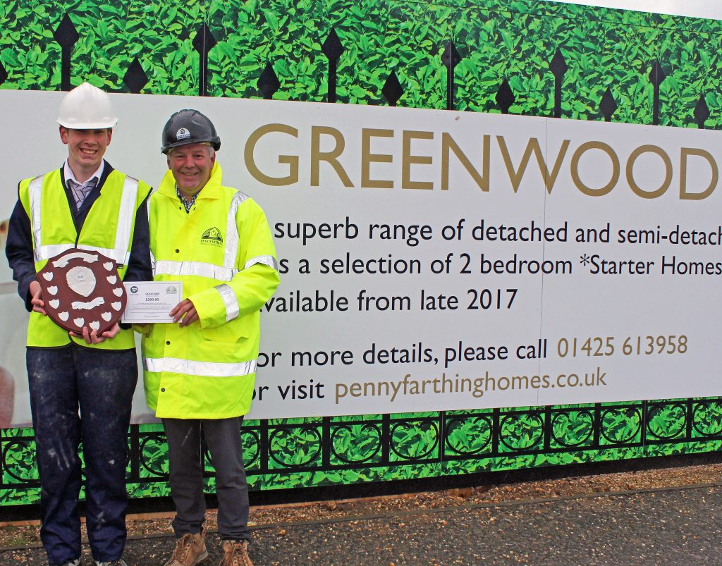 TOOLS TO SUCCEED: The Arnewood School student Nathan Ferris (left) receiving his construction award from Andy Follet, Construction Manager, Pennyfarthing Homes.