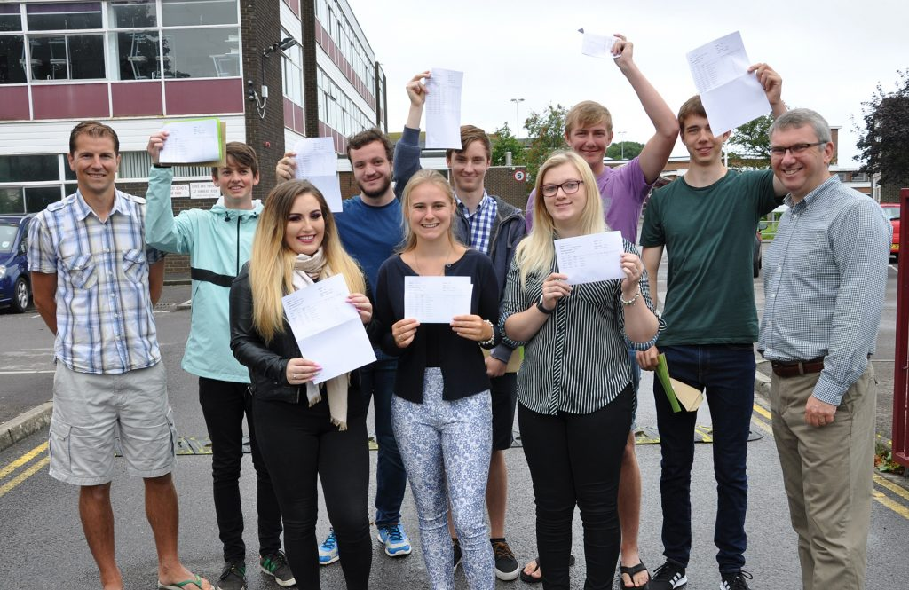 Mark Colman (head of sixth form) LEFT and Nigel Pressnell (headteacher) RIGHT, with some of their star A Level students