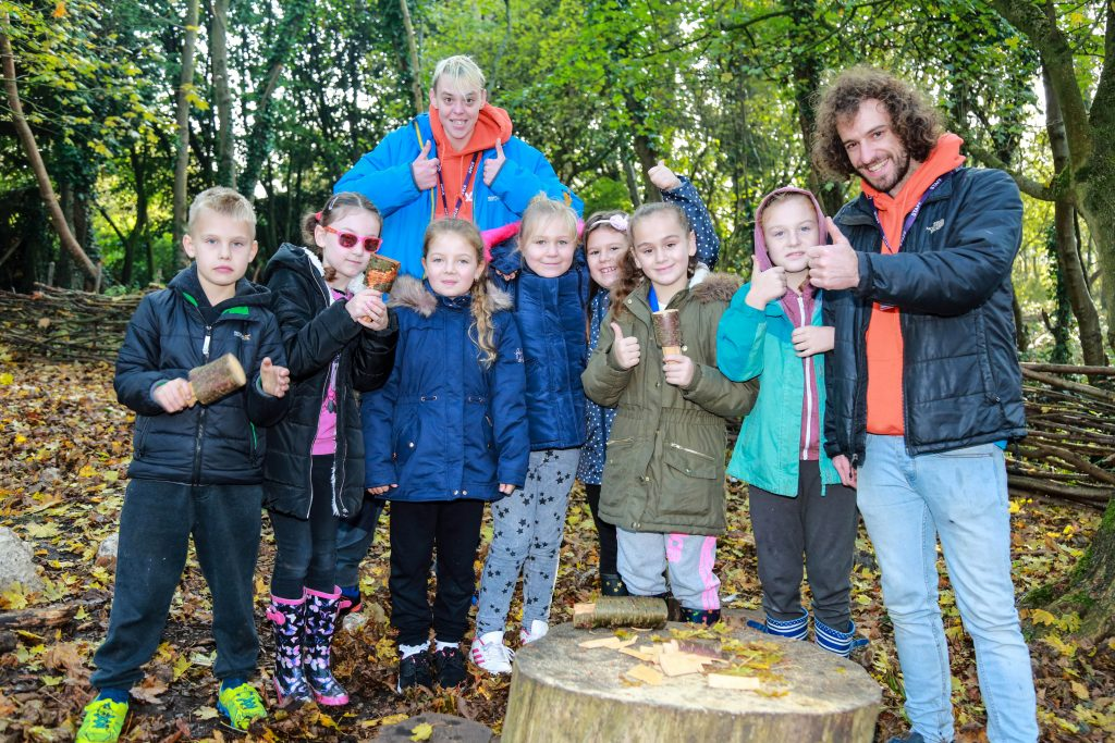 Hightown Primary School enjoyed the activities of the forest School when they paid a visit to the Youth Options Outdoor Learning Centre in Bishopstoke. They are pictured with youth support workers Casey Taylor and Jon Sharps.