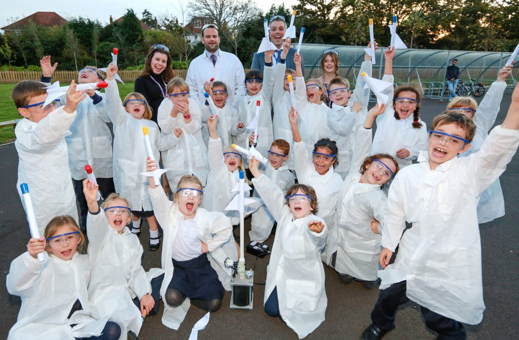 Pupils of Avonwood Primary School enjoy their new Science Club with teacher Mr Clench helped by sixth formers and Avonwood headteacher Mr Jackson.Rocket launching!
