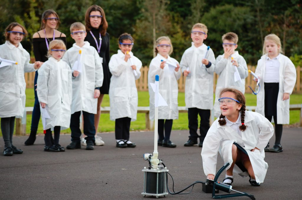 Pupils of Avonwood Primary School enjoy their new Science Club with teacher Tim Clench helped by sixth formers and Avonwood headteacher Chris Jackson.