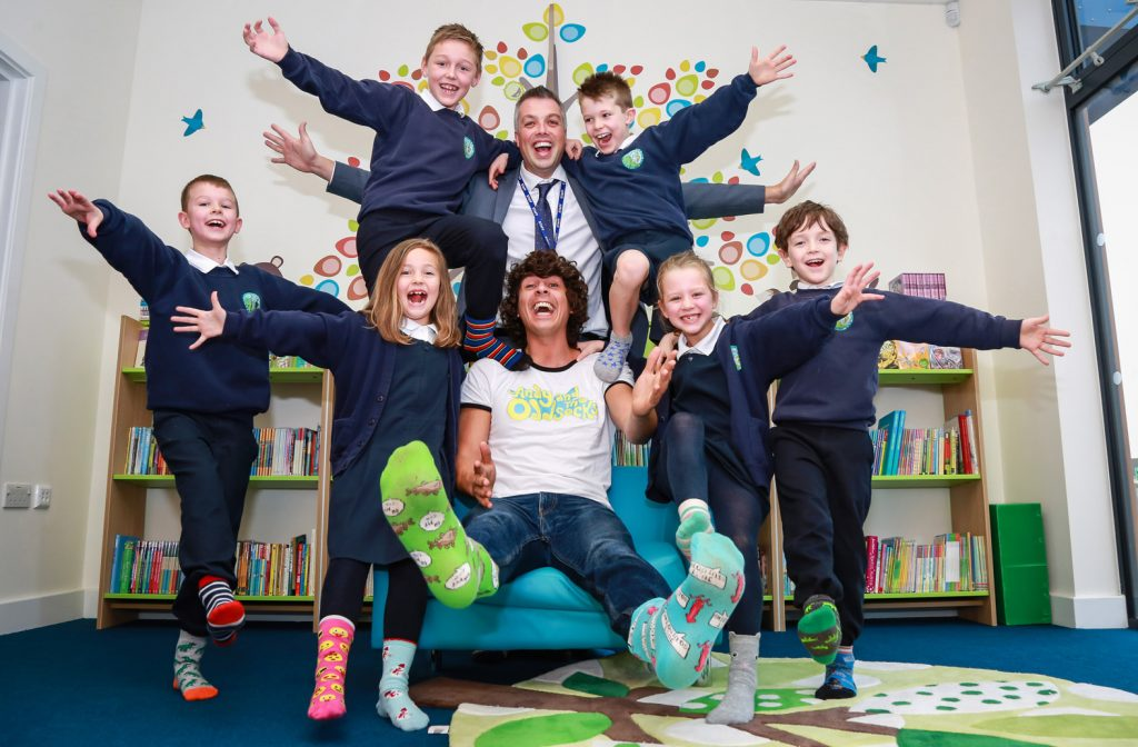 Avonwood Primary School welcomed a visit from CBeebies star Andy Day to reward them for their work done during Anti-Bullying Week . He is pictured with headteacher Chris Jackson and the school friendship ambassadors.