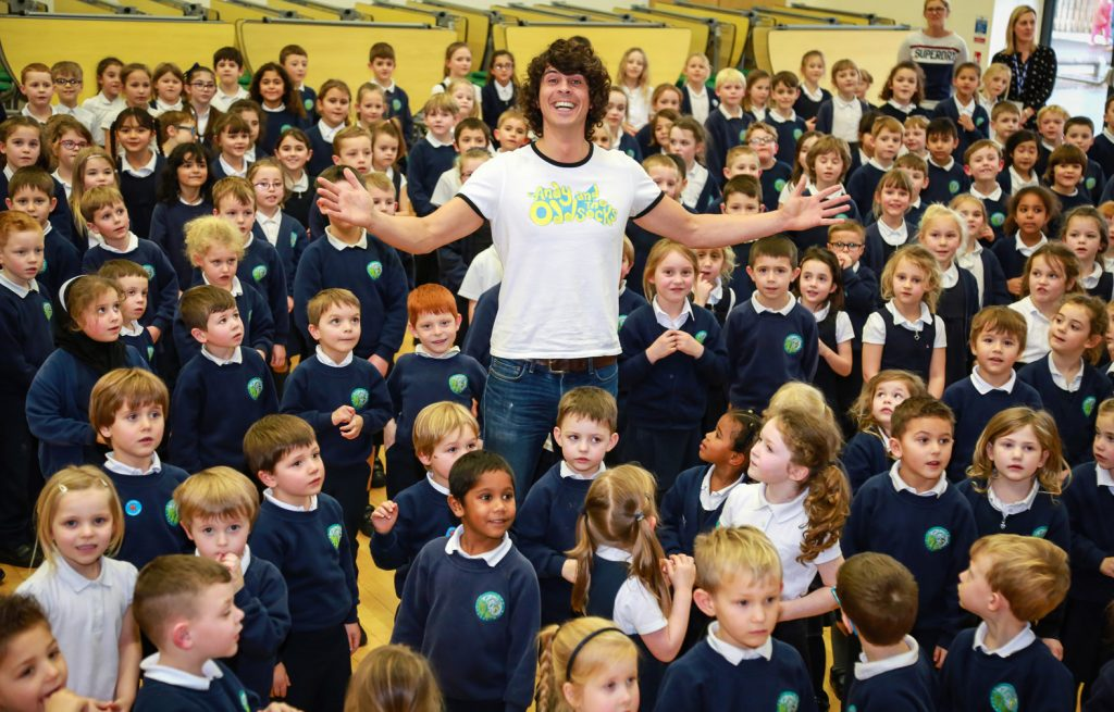 Avonwood Primary School welcomed a visit from CBeebies star Andy Day to reward them for their odd socks campaign during Anti-Bullying Week .