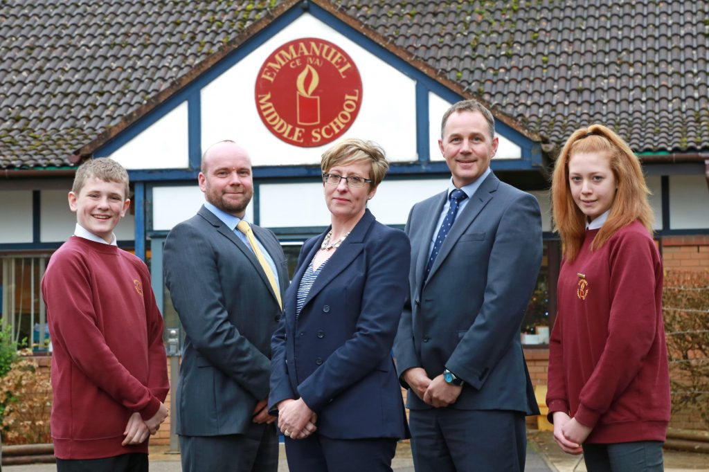 NEW BEGINNINGS: Emmanuel CofE Middle School is the newest member of Wimborne Academy Trust. Acting Head Rob Christopher (centre left) is pictured with CEO of Wimborne Academy Trust, Liz West (centre). Executive Headteacher, Ron Jenkinson (centre right) and Emmanuel Year 8 Lead Ambassadors Ryan Kearn (left) and Shannon Doherty.