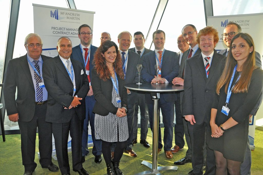 TOP FIRM: Staff from McAndrew Martin at their showcase at the Gherkin in London when they unveiled the company's new structure. Managing director Bill McAndrew is pictured sixth left next to the table with a champagne glass