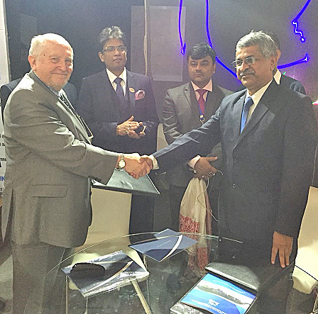 SHAKE: Capt Malcolm Parrott is pictured left with the director of Inland Water Transport Mr Bharat Bhushan Dev Chaudhary (right) signing the MOU