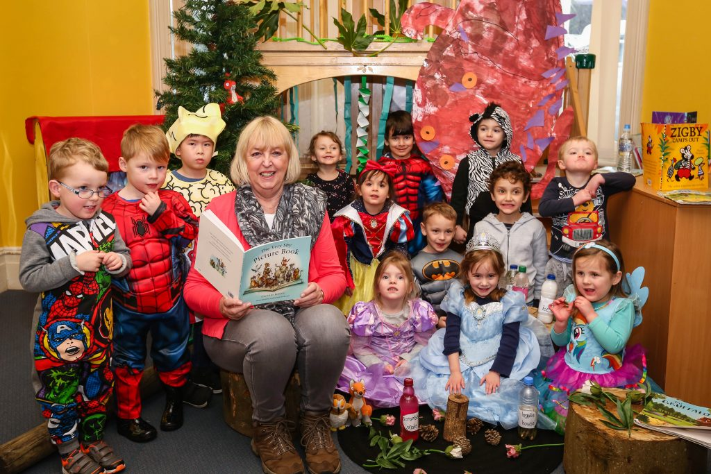 Author Christine Roberts reads for children at Bournemouth Day Nursery.