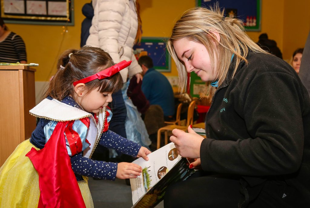 Author Christine Roberts reads for children at Bournemouth Day Nursery and children dressed as their favourite book characters as part of the occasion.