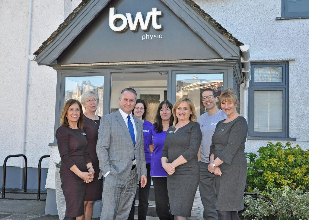 GOOD HEALTH: BWT Physio has become a Platinum Business Partner at the Dorset Chamber. Chamber chief executive Ian Girling is pictured third left with BWT chief executive Juliet Beardsley sixth left with some of the staff at the company's clinic in Poole