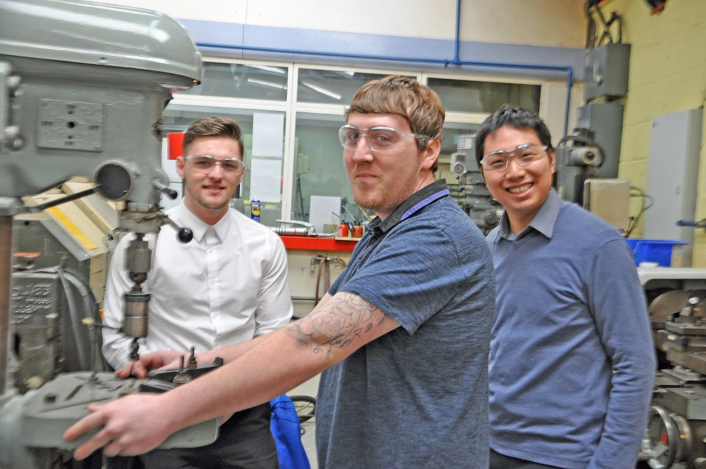SKILLS: Barnbrook Systems Ltd of Fareham invests in youth: From left apprentice Todd Green, apprentice Shane Hutton and graduate engineer Jack Lee at Barnbrook Systems in Fareham