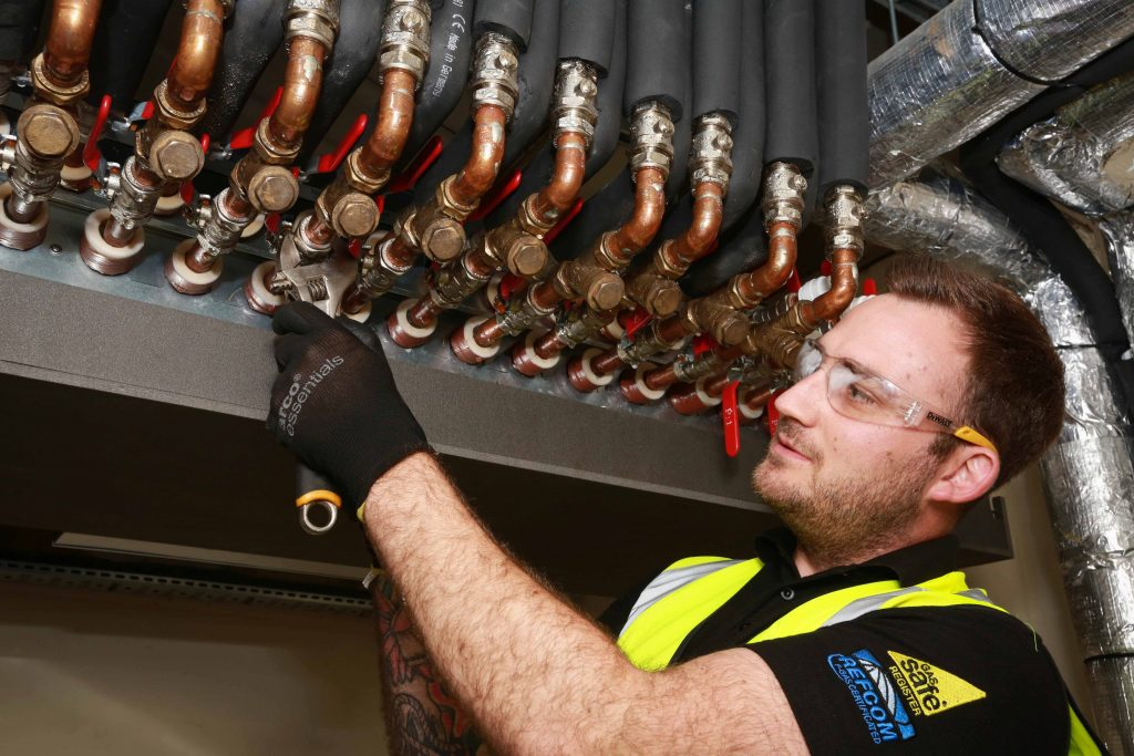 PIPEWORK: Joe Easton from Closewood Ltd adjusts the system (Picture: Paul Collins)