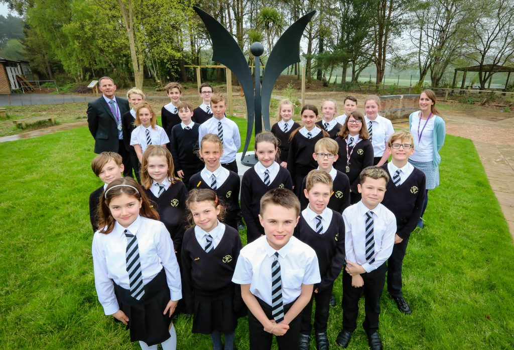 St Michael's CE Middle School has installed a new angel sculpture in its grounds. Pictured with it are members of the school council.
