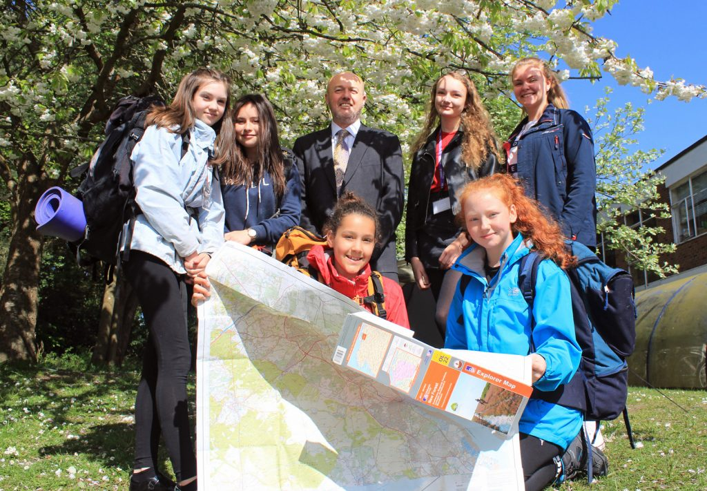 RISING TO THE CHALLENGE: Avonbourne College has entered a record number of students into the prestigious Duke of Edinburgh Awards. Principal Jason Holbrook with some first-time Year 9 participants and Avonbourne sixth formers going for gold.