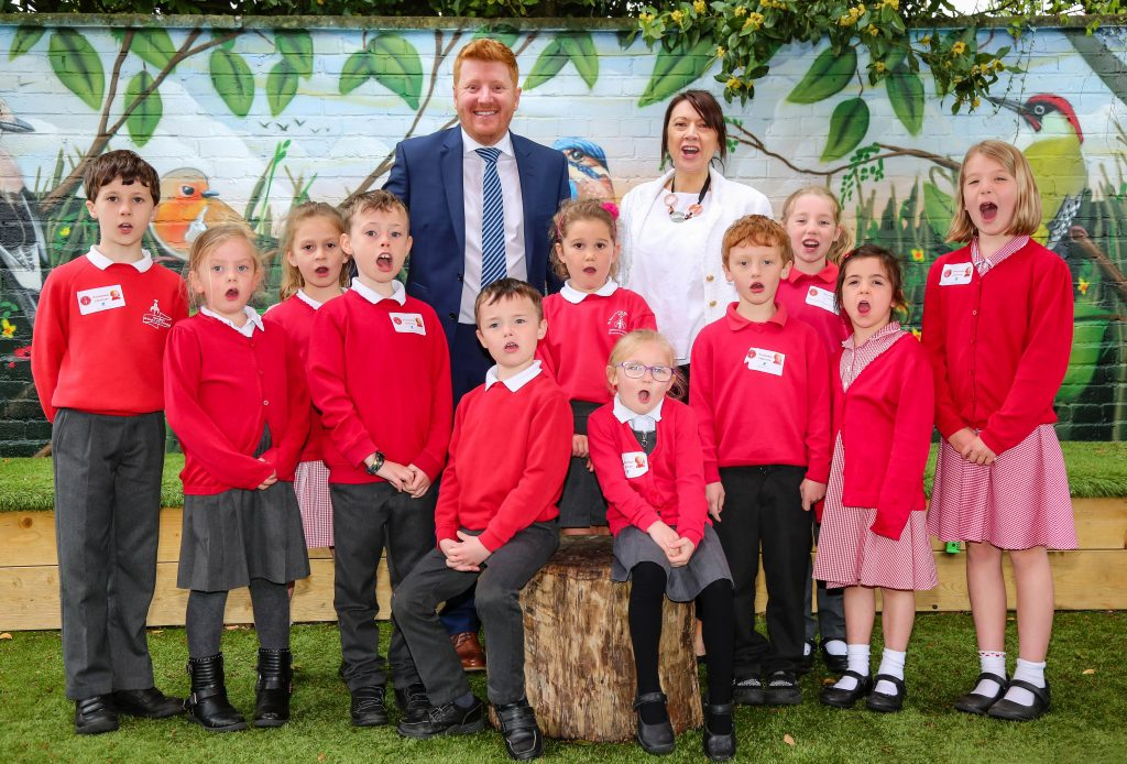 Celebrating their good Ofsted report, St Mary's First School, West Moors headteacher Roy Sewell, Heath Academy Trust chief executive headteacher Justine Horn and pupils.