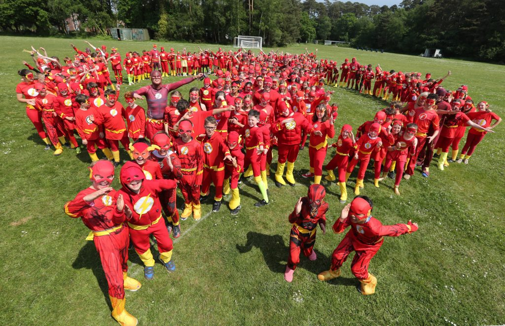 Pupils and staff at St Michael's CE Middle School in Colehill all dressed up for their Flash Superhero record breaking attempt.