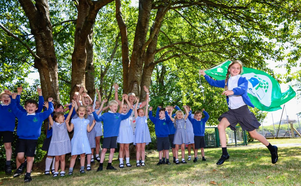 Teacher Jennifer Benn and her eco warriors at Merley First School with the Eco School Green Flag they have been awarded for their wide range of enviromental work.