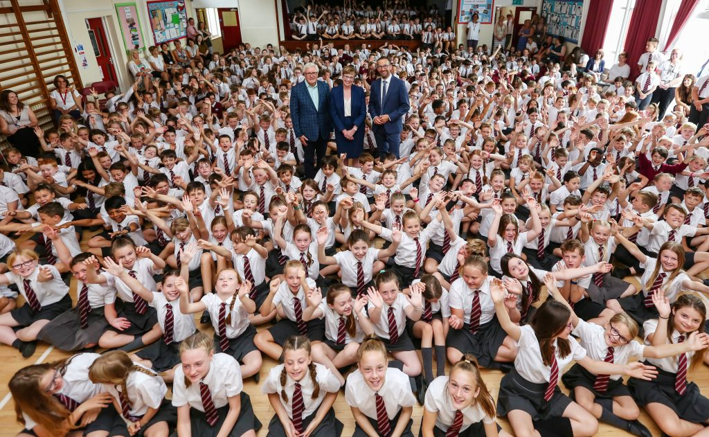 Lockyer's Middle School in Corfe Mullen has joined Wimborne Academy Trust's group of first and middle schools. Pictured with pupils are WAT chair of trustees John Dickson, CEO Liz West and Lockyer's headteacher Mark Legge.
