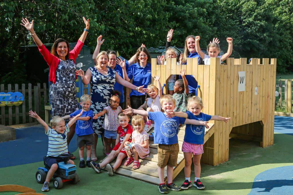 Blackfield Nursery School staff and children celebrate their good Ofsted report.
