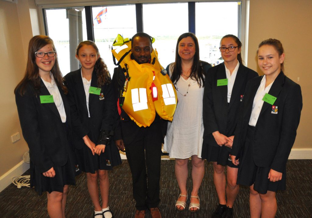 Avonbourne College students were given a fascinating insight into the world of engineering thanks to an event hosted by the RNLI, here they are joined by the RNLI's Beth Gill demonstrating the lifejacket she invented as worn by Avonbourne College science teacher Taz Chikwavira.