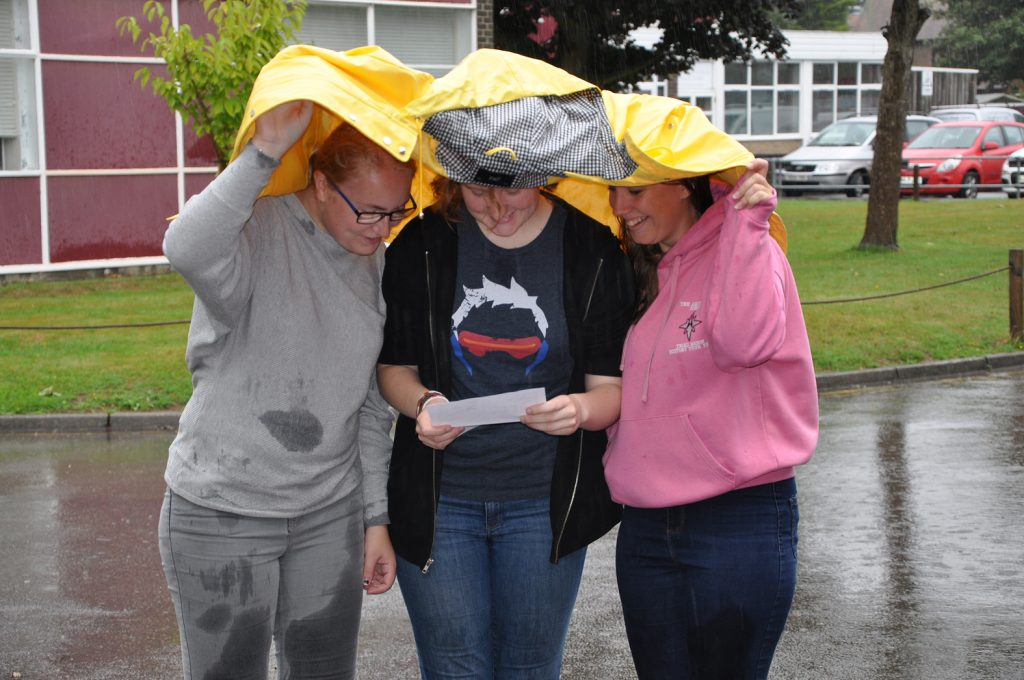 The weather did not rain on their parade as Aimee Douglass, Kaylyn Snelgrove and Abbey Jones pick up their results at Arnewood on A Level results day.