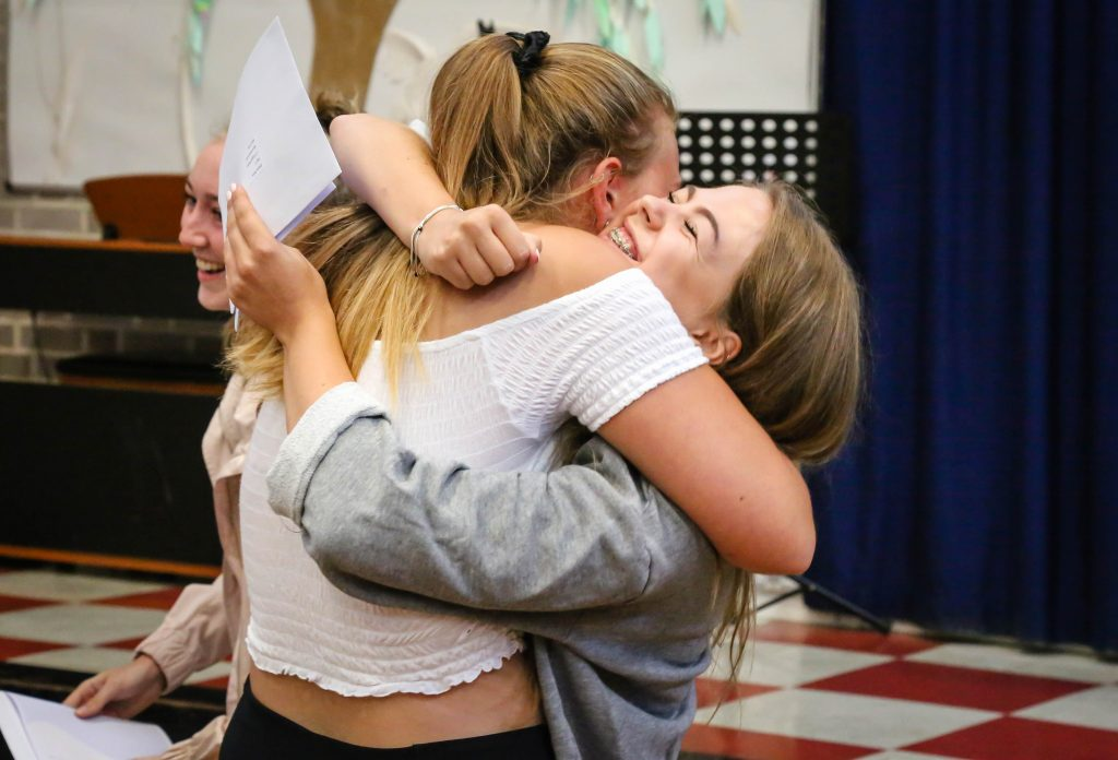 Sixth Form students at Avonbourne College receive their A Level results.  Hannah Amey is congratulated by friends.