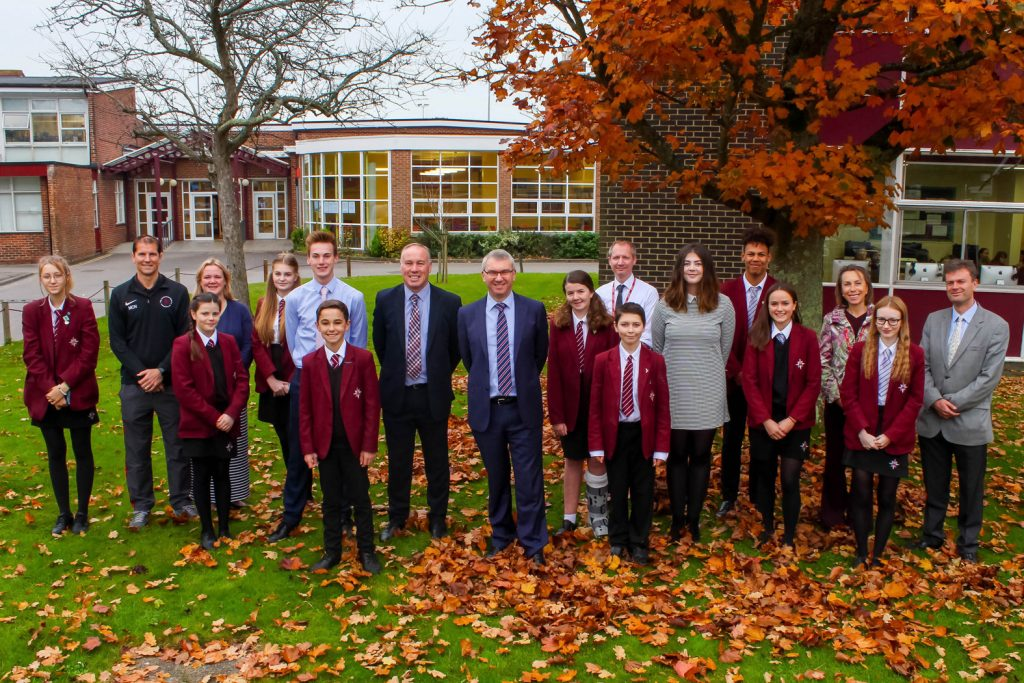 School leaders and members of the student school council join headteacher Nigel Pressnell (centre), deputy headteacher Craig Price (left of Nigel Pressnell) and head boy and head girl, Thomas Hopkins and Olivia Hilton-Foster, to celebrate their Good Ofsted.