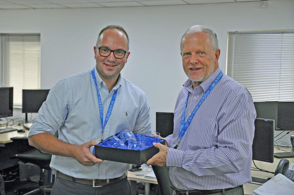 Director of architecture James Bengree, left, marks ten years of service at Portsmouth firm McAndrew Martin with managing director Bill McAndrew, right