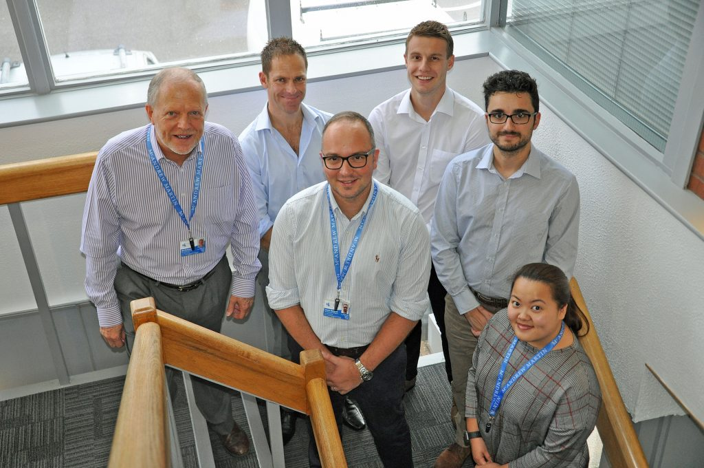 HEIGHTS: Director of architecture James Bengree marks ten years of service at Portsmouth firm McAndrew Martin with new recruits. From left, managing director Bill McAndrew, Richard Knapp, director of architecture James Bengree, Dan Harris, Jesus Piedra and Mandi Le