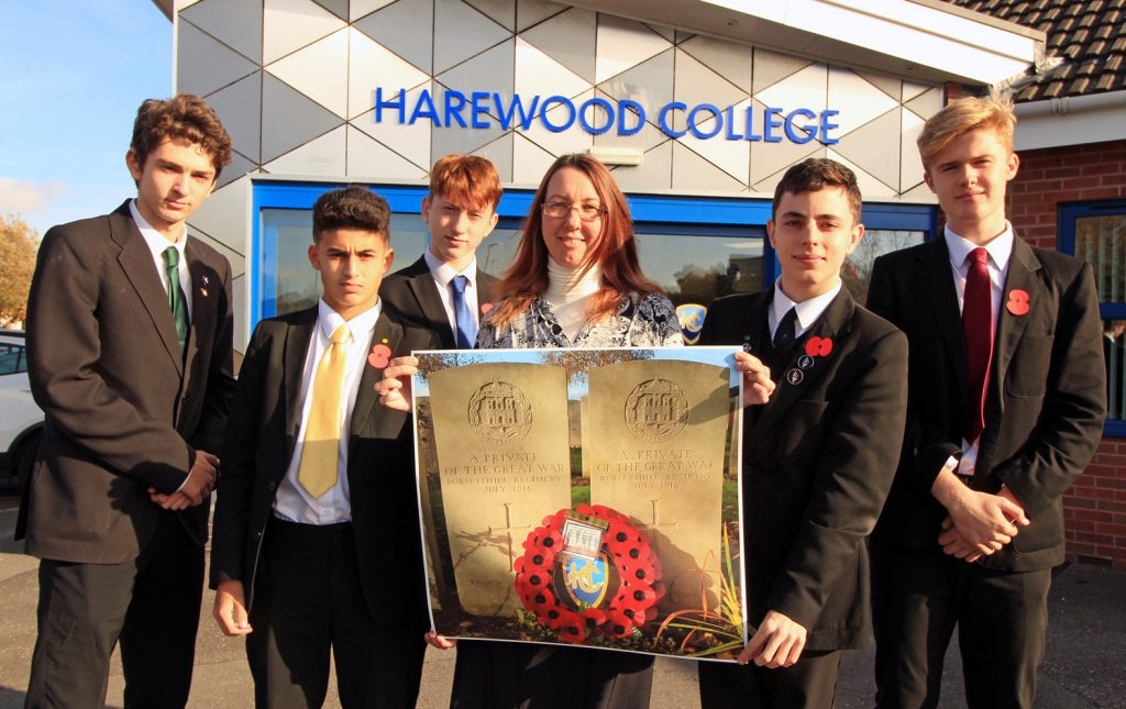 Harewood College pastoral support worker Annabel Major visited the WWI cememteries in France for the Armistice centenary commemorations. There she laid wreaths on behalf of the college. Here she is pictured with a photo of the wreath on the graves of two unknown Dorset soldiers and the college's head and deputy head boys.
