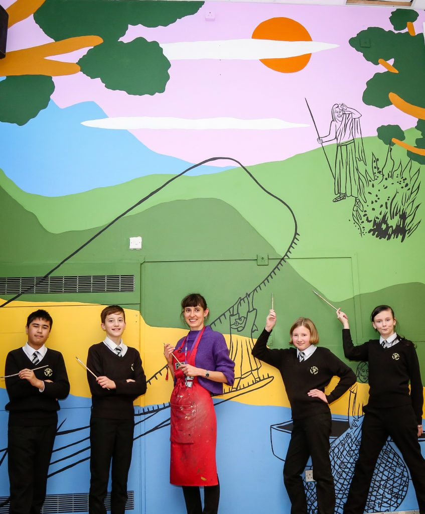 St Michaels Cof E Middle School in Colehill are completing a new mural covering the full width of their school hall wall. Pupils painted the mural with the help of art technician Bridie Cheeseman.