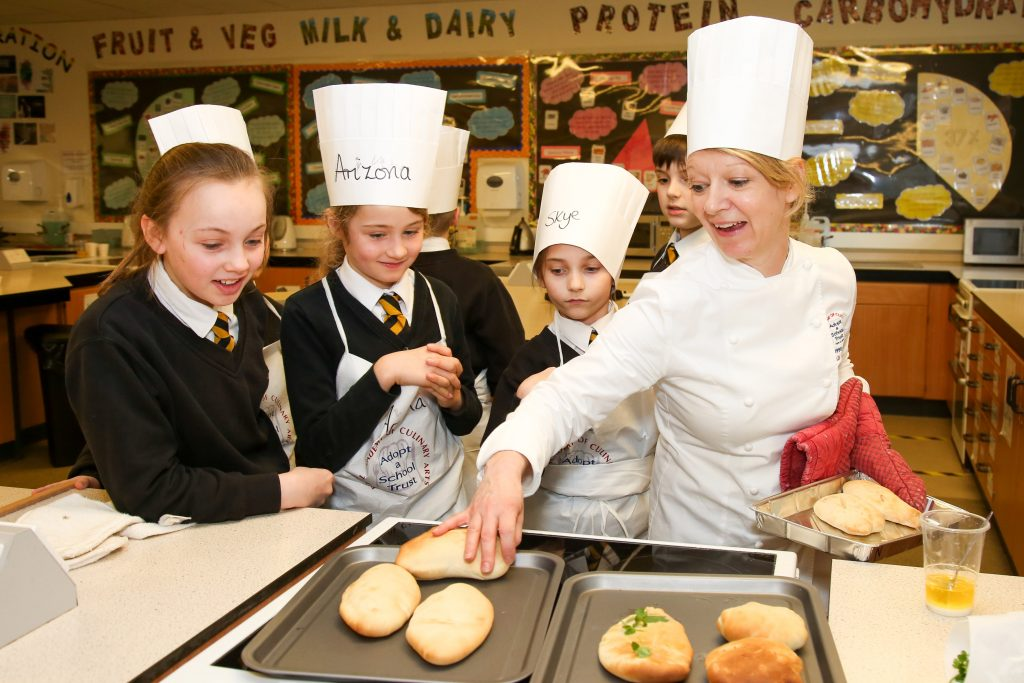 ear 5 and 6 pupils at Allenbourn Middle School in Wimborne take part in a cooking session run by Sarah Howard from The Royal Academy of Culinary Arts as part of its Adopt a School programme.