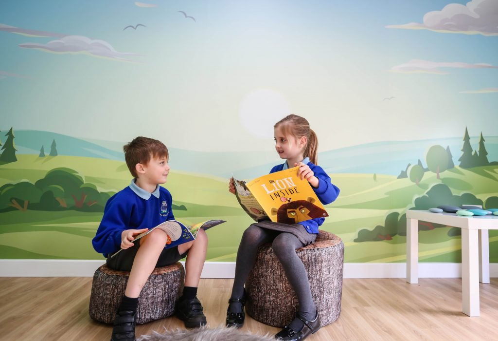 Pupils reading in the new NEST area at Fawley Infant School