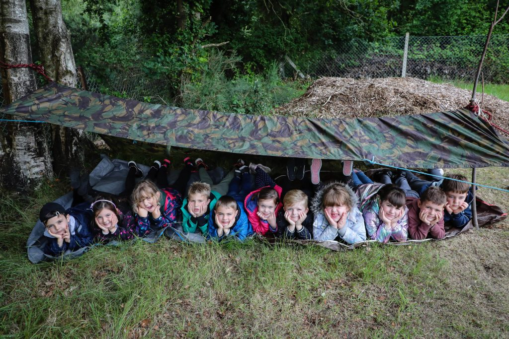 Hillside First School survival day. Pupils took on a number of survival challenges after hearing the story of Robinson Crusoe. Building shelters.