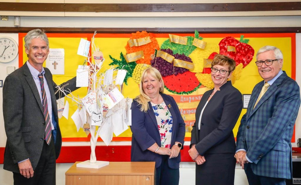 Senior leaders celebrate Verwood CE First School's successful SIAMS inspection. Pictured in front of the school's prayer tree are: headteacher Adam Parsons, School Academy Committee Chair Jane Mearns , Wimborne Academy Trust CEO Liz West and Chair of Trustees John Dickson.