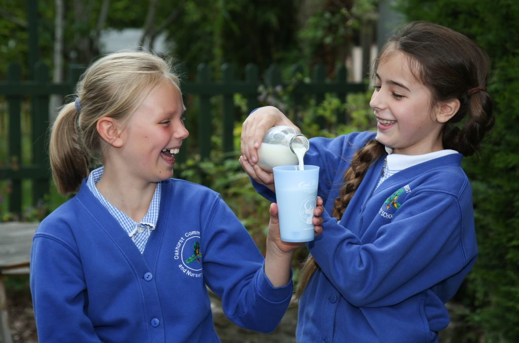 Pupils at Oakhurst Community First and Nursery School in West Moors who have successfully campaigned to have their daily milk cartons and straws replaced with reusable milk bottles and cups.
