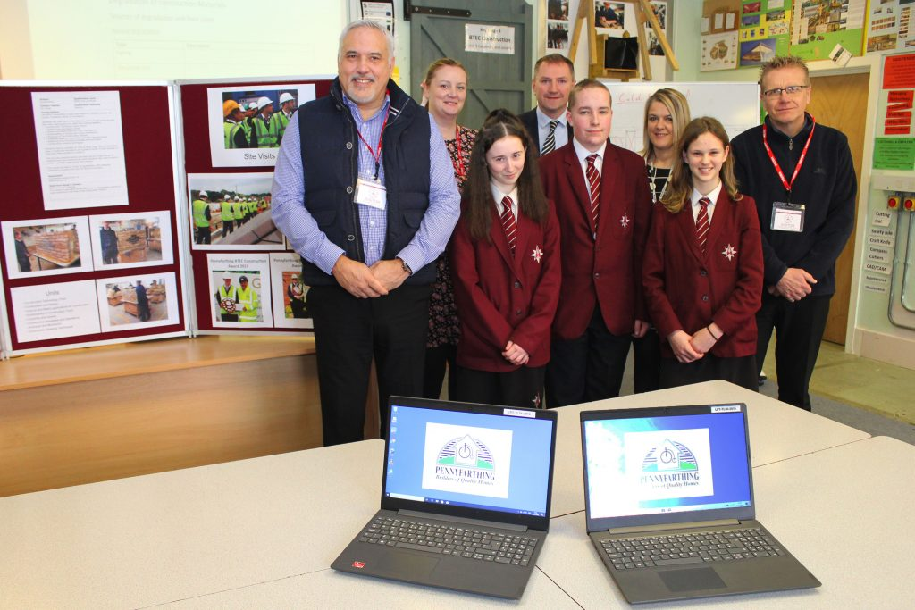 Pennyfarthing Homes has donated £500 to The Arnewood School to help purchase a new computer. The company responded to a fundraising drive from the school's PSA, which is aiming to raise £10,000 for a refurbished IT room and equipment. Picture are (from left to right) Steve Tyrell (Pennyfarthing's Construction Director), Sarah Milligan (IT Manager Arnewood), Paul Clarke (Head of Design and Technology, Arnewood), Joanne Ankers (Parents Staff Association), and Phil Langdown (Pennyfathing's Contracts Manager) with Year 9 Technology students.